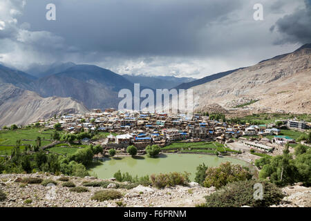 Nako village set against clouded Himalayan mountains in the Kinnaur district of Himachal Pradesh, Northern India, - Stock Photo