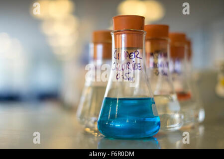 Chemistry lab glass beakers chemicals science - Stock Photo