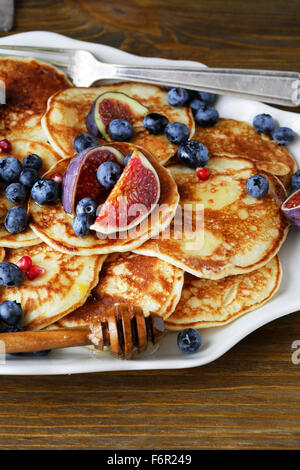 breakfast pancakes with fresh berries, food close-up - Stock Photo