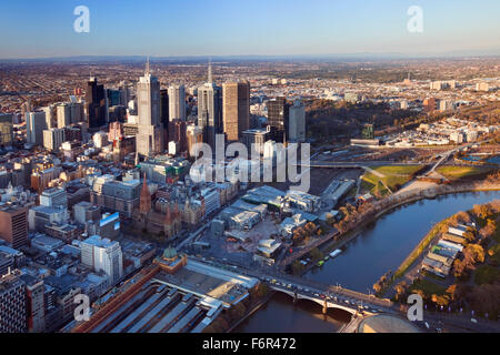 Downtown Melbourne, Australia with Flinders Street Station in the foreground. Photographed from above at sunset. - Stock Photo
