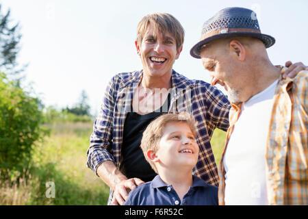 Portrait of happy multi-generation family outdoors - Stock Photo