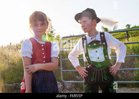 Portrait of boy and girl in traditional Bavarian costume - Stock Photo