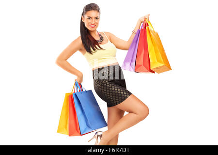 Beautiful woman holding shopping bags and smiling isolated on white background - Stock Photo