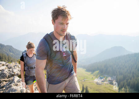 Young couple hiking in mountain landscape - Stock Photo