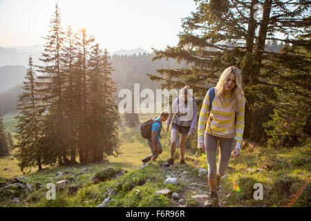 Group of friends hiking in mountain landscape - Stock Photo