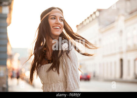 Young woman with tousled hair and headband - Stock Photo