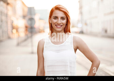 Redheaded woman in white summer dress - Stock Photo