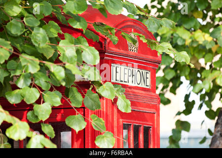 Traditional Red telephone box in Highgate, London - Stock Photo