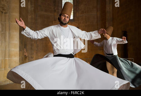 Whirling dervishes perform in Nicosia, northern Cyprus - Stock Photo