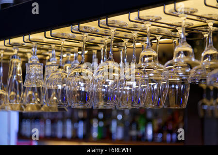 A lot of glasses hanging in a row - Stock Photo