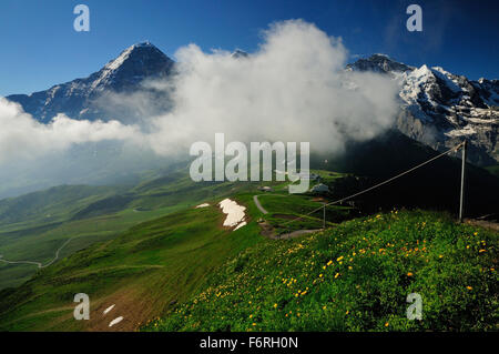 Early morning cloud covering the alpine peaks above Berghaus Mannlichen. - Stock Photo