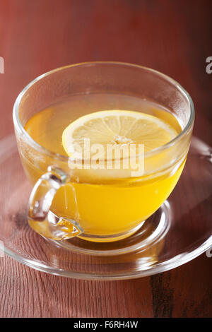 hot lemon ginger tea in glass cup - Stock Photo