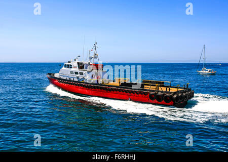Oil rig support vessel leaves Santa Barbara harbor on it's way to the many rigs in the vicinity - Stock Photo