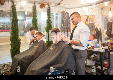 New York, USA. 19th Nov, 2015. Customers get haircuts from 'Made Men' in 'Square Village' outside the New York Stock - Stock Photo