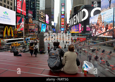 New York, USA. 19th Nov, 2015. Visitors are seen in the Times Square in Manhattan, New York City, the United States, - Stock Photo