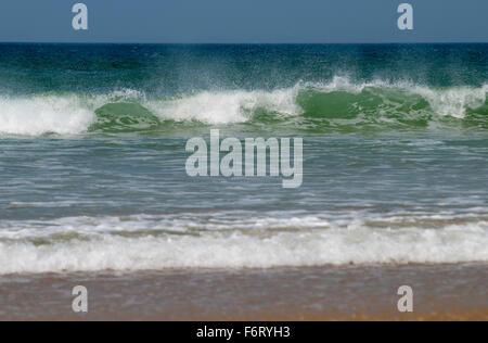 Waves crashing onto a beach in Cornwall, England, UK - Stock Photo