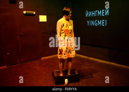 Moscow, Russia. 19th Nov, 2015. Chinese artist Duan Yingmei makes her live performance 'Behind The Door' in Solyanka - Stock Photo