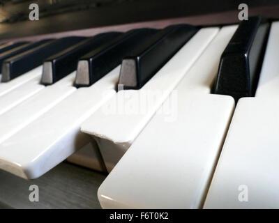 Closeup of broken key of Electronic Piano synthesizer Keyboard - Stock Photo
