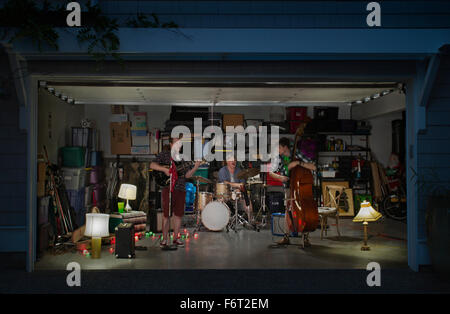 Caucasian band playing in garage