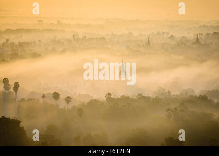 Aerial view of towers in misty landscape - Stock Photo