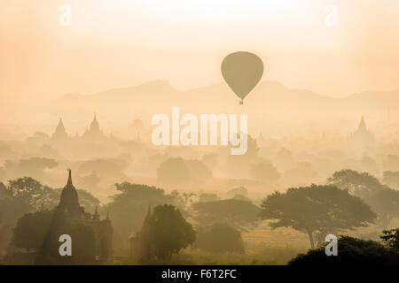 Aerial view of hot air balloons flying over towers - Stock Photo