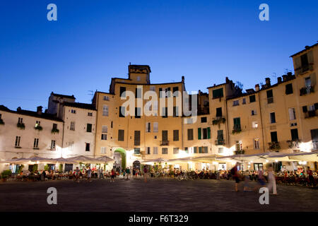 Piazza dell'Anfiteatro in a warm summer evening, Lucca, Italy. - Stock Photo