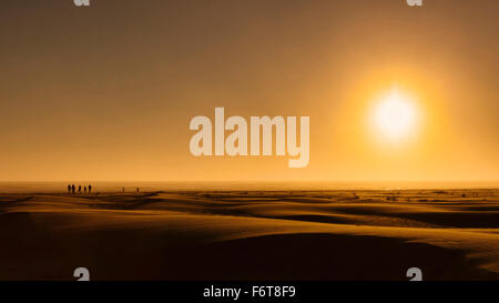 Sunrise over beach sand dunes - Stock Photo