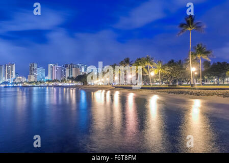Honolulu city skyline reflection in ocean, Hawaii, United States - Stock Photo