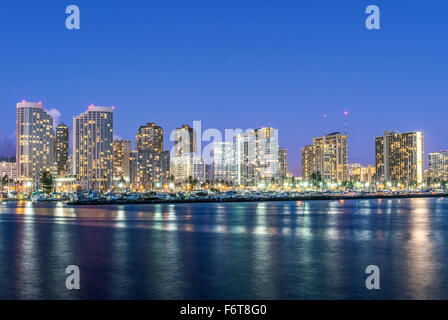 Honolulu city skyline reflection in ocean, Hawaii, United States Stock Photo
