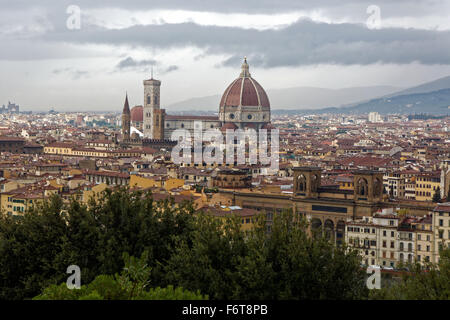 The Duomo of the Cattedrale di Santa Maria del Fiore, or Cathedral of Saint Mary of the Flower dominates the skyline - Stock Photo