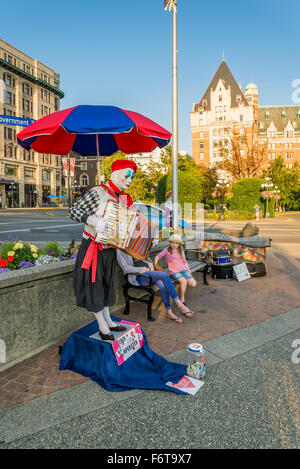 Mime with accordian, busking in Victoria, British Columbia, Canada - Stock Photo