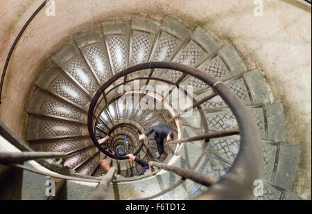 Looking down the Spiral Staircase at the Arc. The curving spiral staircase that leads down from the top of the Arc - Stock Photo