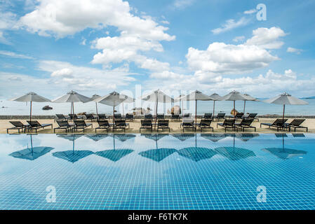 Summer, Travel, Vacation and Holiday concept - Tropical beach resort with lounge chairs and umbrellas in Phuket - Stock Photo