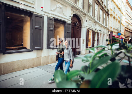 Austria, Vienna, two female friends exploring the old town - Stock Photo