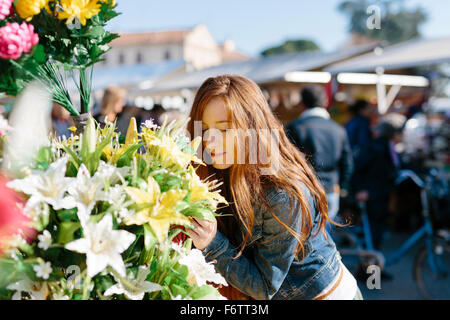 Woman at flower market - Stock Photo