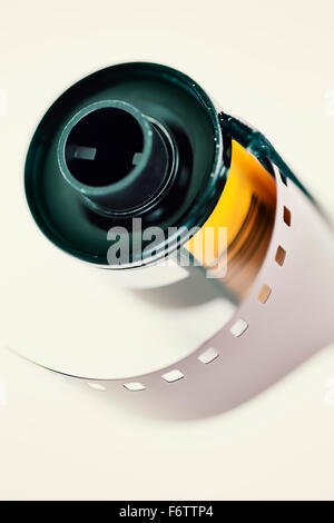 Negative film in front of light background, close-up - Stock Photo