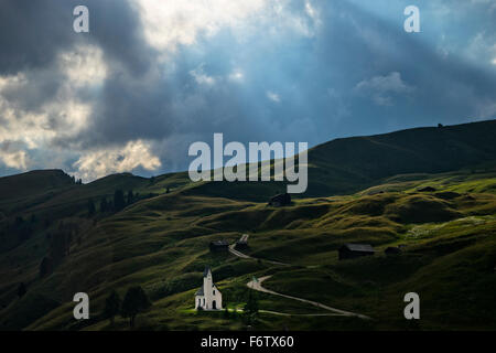 Italy, South Tyrol, Small church on Gardena pass in a stormy day - Stock Photo