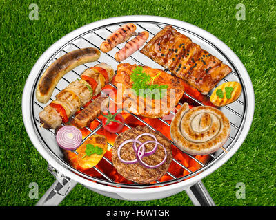 white kettle grill with grilled food - Stock Photo