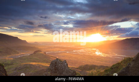 Sunset over a river valley in Porsmork, Iceland. - Stock Photo