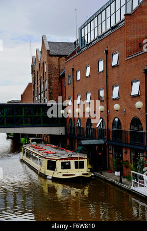 A 'narrowboat' or narrow boat is of distinctive design, made to fit the narrow canals of the United Kingdom. - Stock Photo