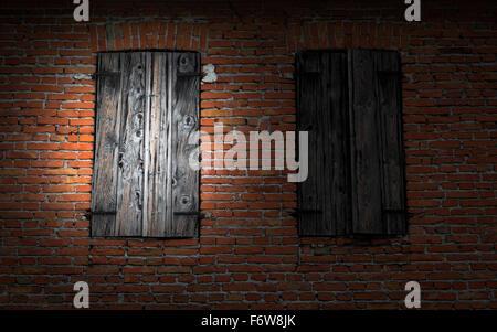 Window on red brick wall illuminated by a flashlight. - Stock Photo