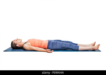 woman relaxes in yoga asana savasana outdoors stock photo