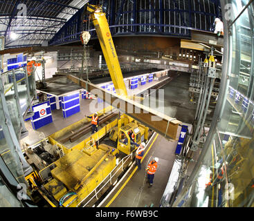 Overnight construction and renovation on London's Underground rail network. Temporary beams are erected at Earls - Stock Photo