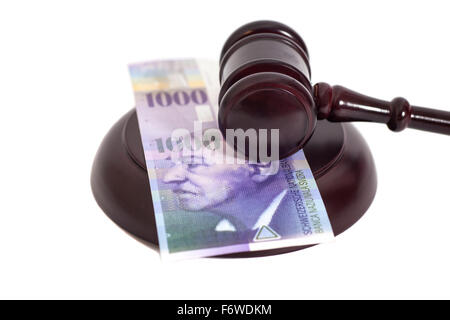 Judge Gavel and Swiss Thousand Franc Currency isolated - Stock Photo