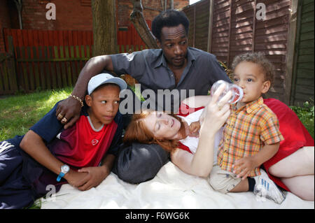 Multiracial family group sitting and relaxing in the garden, - Stock Photo
