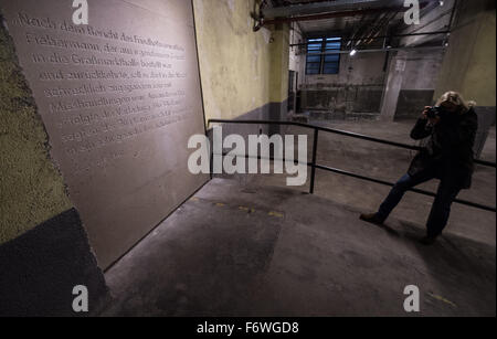 A woman photographs a memorial plaque in the  the newly opened Holocaust Memorial site in the cellar of the European - Stock Photo