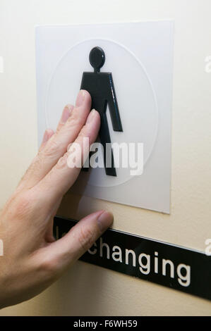 Raised symbol on the door of a male toilet to assist visually impaired people read the sign, - Stock Photo