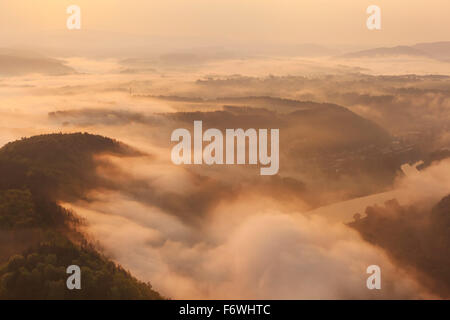 View over Valley with Elbe river in morning mist, Bad Schandau, Saxon Switzerland, Saxony, Germany - Stock Photo