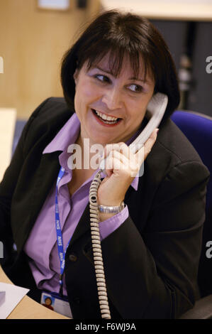Woman working in the NHS offices, - Stock Photo