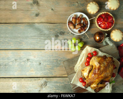 Christmas and thanksgiving savory and sweet food selection on top of a wooden background with copyspace - Stock Photo